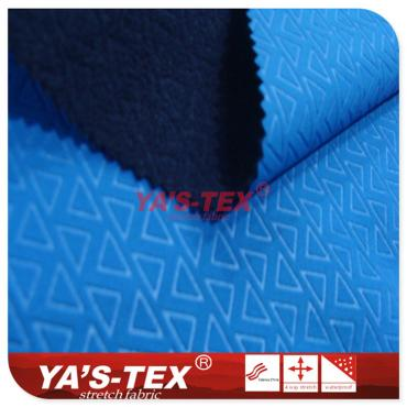 Embossed polyester four-way stretch fabric composite fleece