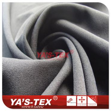 Polyester four-way stretch, both sides twill