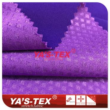 Twill polyester four-way stretch composite knitted embossed cloth